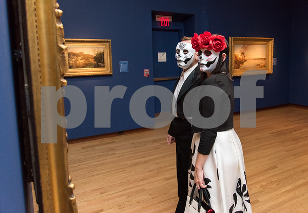 10/27/17 Wesley Bunnell | Staff The New Britain Museum of American Art held their Museum After Dark 11th Annual Halloween Bash on Friday evening. Sean & Orla Pasciolla of Southington browse the artwork.