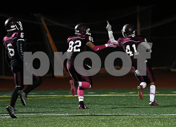 10/27/2017 MIke Orazzi | Staff Bristol Central's Ryan Rodriguez (82) and Dominic Va on a blocked punt returned for at TD against CapitalPrep/Achievement at BC Friday night.