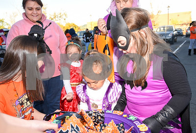 10/27/17  Wesley Bunnell | Staff  The Foster Care Unit & Fatherhood Leadership Team of the State of CT Department of Children and Families held a trunk-or-treat for children on Friday evening with volunteers in costume and passing out candy from decorated cars. Young trunk-or-treaters look over the candy choices.