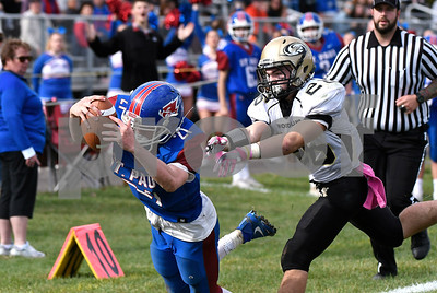 10/28/2017 Mike Orazzi   Staff St. Paul's Damien Rabis (21) and Woodland's Nicholas Rousseau (26) during Saturday's football game in Bristol.