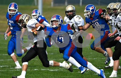 10/28/2017 Mike Orazzi   Staff St. Paul's Pedro Garcia (47) and Woodland's Zach Cochran (5) during Saturday's football game in Bristol.