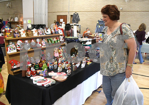 10/28/2017 Mike Orazzi | Staff Linda Gregg looks over items for sale during the Bristol Senior Center Craft Fair on Saturday.
