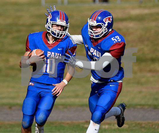 10/28/2017 Mike Orazzi | Staff St. Paul's Kevin Ashworth (10) and R.J. Murphy (53) after a TD during Saturday's football game with Woodland.
