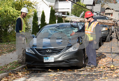 10/30/17  Wesley Bunnell   Staff  At approximately 8:30pm on Sunday night a falling tree took down a utility pole and its electric lines causing a transformer to explode startling residents on Summer St. A utility pole fell severely damaged a black Hyundai. Workers from Clean Harbors and Eversource assess the damage.