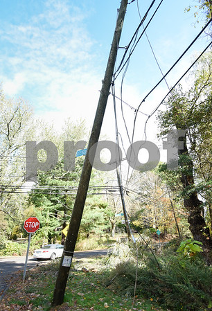 10/30/17 Wesley Bunnell | Staff High winds and heavy rain on Sunday and into Monday morning caused trees to fall and disrupt services to city residents. A pole leans severely to one side with down wires at the intersection of Shuttlemeadow and Reservoir on Monday afternoon.