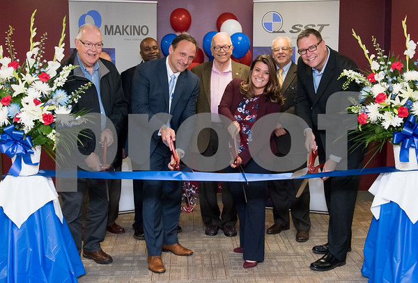 10/30/17 Wesley Bunnell | Staff Makino, Inc. held a ribbon cutting on Monday afternoon at its new facility on Myrtle Street. Regional Manager Barry Boman, Executive Director of New Britain Downtown District Gerry Amodio, candidate for Alderman Jason Gibson, Vice President of Die Mold Andre Ey, Alderman Don Naples, Mayor Erin Stewart, Economic Development Director Bill Carroll and Consumables Sales and Operations Manager Tom Kucharski.