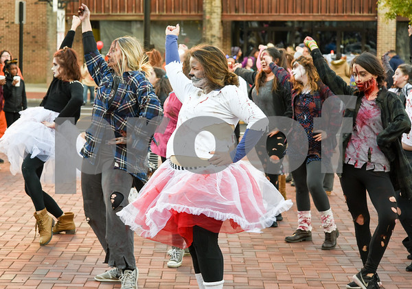 10/31/17 Wesley Bunnell | Staff The New Britain Trick or Treat Halloween Safe Zone drew a large crowd to Central Park on Halloween night. Dancers from the YWCA dance team perform to Michael Jackson's Thriller.
