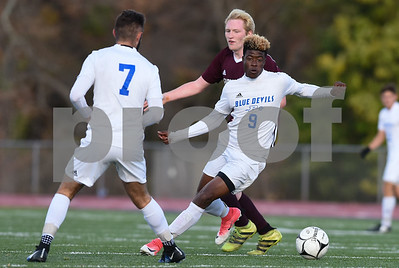 10/31/17  Wesley Bunnell | Staff  Farmington @ Plainville boys soccer on Tuesday afternoon at Plainville High School. Plainville's Jordan Bishop (7) one Plainville's Dane Stephens (9).