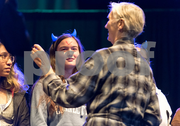 10/31/17 Wesley Bunnell | Staff Trinity-on-Main held screenings of The Rocky Horror Picture Show on Halloween evening. Here volunteer Michele Rochette marks first time viewers of the show with a V on their forehead.