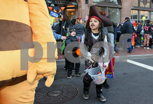 10/31/17 Wesley Bunnell | Staff The New Britain Trick or Treat Halloween Safe Zone drew a large crowd to Central Park on Halloween night. Jabriel Collazo, age 9, walks up behind Little Poland mascot Maja the Bee.