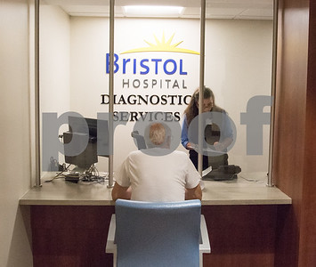 10/04/17  Wesley Bunnell | Staff  Bristol Hospital held a ribbon cutting on Wednesday morning for their renovated Diagnostic Services Department. Administrative Support Associate Donna Cyr checks in a patient.