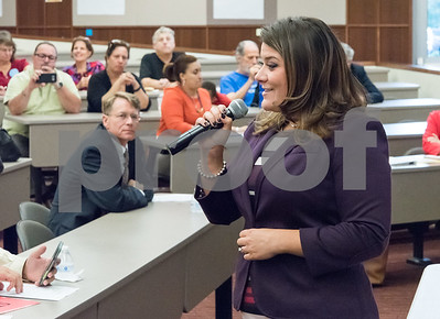 10/05/17  Wesley Bunnell | Staff  Mayoral candidates Erin Stewart and Merrill Gay participated in an answer and question event relating to education at New Britain High School on Thursday .  Democratic challenger Merrill Gay, L, looks on as Mayor Erin Stewart answers the first question.