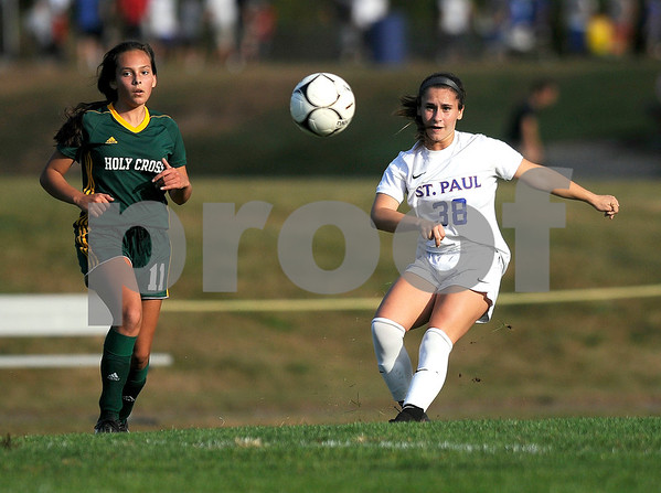 10/5/2017 Mike Orazzi | Staff Holy Cross' Delia Murphy (11) and St. Paul's Briana Senese (38) in Bristol Thursday.