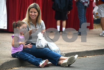 10/7/2017 Mike Orazzi | Staff Megan Charette and her daughter Olivia,3, seat some apple fritters during the 49th Apple Harvest Festival in Southington Saturday.