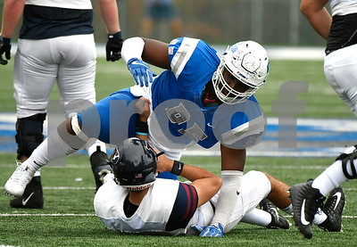 10/7/2017 Mike Orazzi | Staff CCSU's Brandon Puritt (95) and the Penn Quakers' Nick Robinson (8) during Saturday's football game in New Britain.