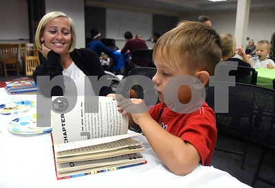 10/7/2017 Mike Orazzi | Staff Ela Szymczyk as her son Evan,4, flips through a book while celebrating the123rd birthday of the Plainville library Saturday afternoon.