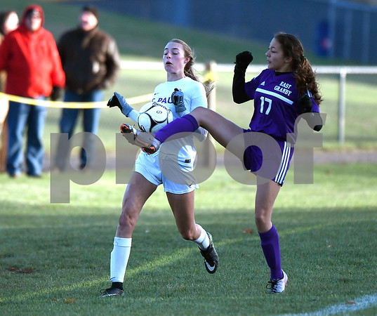 11/11/2017 Mike Orazzi | Staff St. Paul's Addison Davis (33) and East Granby's Stephanie Crocker	(17) during the Class S Quarterfinals held at St. Paul Catholic High School Saturday. St. Paul won 2-1 in double overtime.