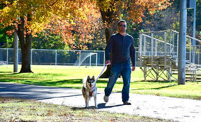 "10/25/2018 Mike Orazzi | Staff Joe DePaola while walking his dog Zoey in Plainville""s Norton Park Thursday afternoon."