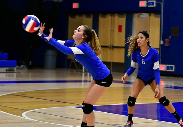 10/25/2018 Mike Orazzi | Staff Plainville's Victoria Corriveau (4) and Sam Lozefski (5) during a loss to Kennedy during girls volleyball in Plainville Thursday night.