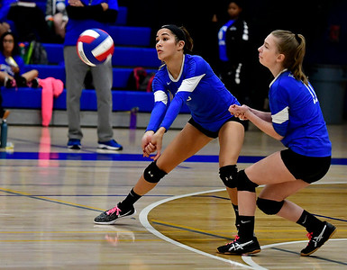 10/25/2018 Mike Orazzi | Staff Plainville's Samantha Lozefski (5) and Samantha Paradis (11) during a loss to Kennedy during girls volleyball in Plainville Thursday night.