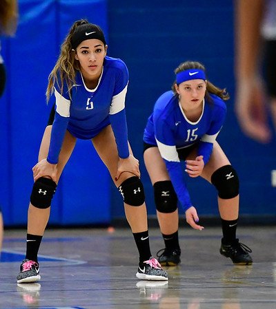10/25/2018 Mike Orazzi | Staff Plainville's Samantha Lozefski (5) and Olivia Gajor (15) during a loss to Kennedy during girls volleyball in Plainville Thursday night.
