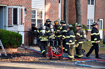 10/25/2018 Mike Orazzi | Staff Bristol firefighters on scene of a house fire at a three story townhouse fire on Beths Avenue in Bristol Thursday afternoon.