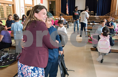 10/01/18  Wesley Bunnell | Staff  Mayor Erin Stewart hugs Jose Perez at Lincoln Elementary School on Monday afternoon after she handed him his new backpack which was donated by Costco. The backpacks were distributed to children at Lincoln who participate in the New Britain Parks and Recreations after school program.