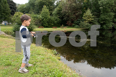 10/01/18  Wesley Bunnell | Staff  Kevin Rodriguez, age 4, reels in to check his bait after getting a couple of hits while fishing at Pine Lake on Monday afternoon.