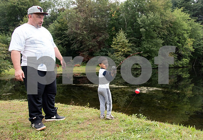 10/01/18  Wesley Bunnell | Staff  Kevin Rodriguez, age 4, prepares to cast his bait into the water as Uncle William Perry looks on while fishing at Pine Lake on Monday afternoon.