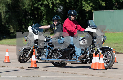 10/05/18  Wesley Bunnell | Staff  New Britain Police Ofc. Peter Scirpo, front, rides a police motorcycle through an obstacle course set up at Willow Brook Park on Friday afternoon as Ofc. Wojtek Sztachelski follows behind.