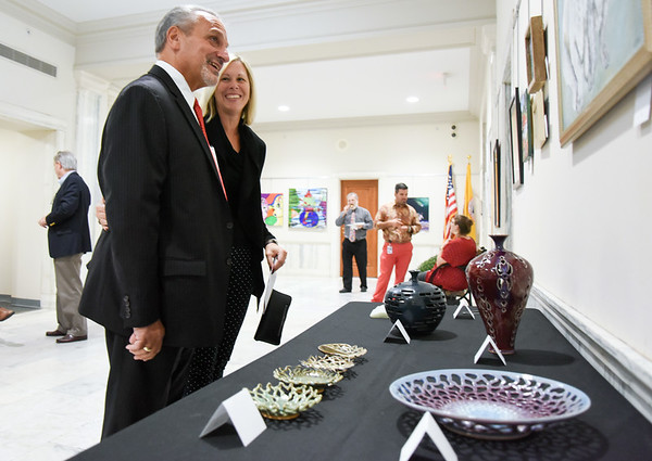 10/10/18 Wesley Bunnell | Staff New Britain's Acting Director of Support Services Paul Salina stands with Smith Elementary Principal Karen Falvey while looking over artwork on display at city hall on Wednesday afternoon. Artwork from CSDNB art teachers is on display at city hall through November 20th as part of Leading by Example III. The exhibit is sponsored by Mayor Erin Stewart's Art in the Heart of the City series and the New Britain Britain Commission on the Arts.