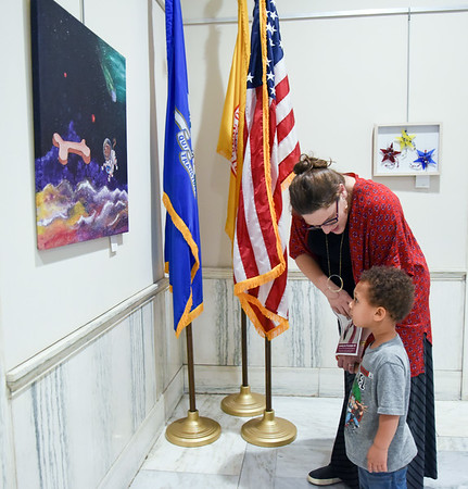 10/10/18 Wesley Bunnell | Staff CSDNB art teacher Kristina Tsantiris shows her 2 year sold son Corbin the artwork on display at city hall on Wednesday afternoon. Artwork from CSDNB art teachers is on display at city hall through November 20th as part of Leading by Example III. The exhibit is sponsored by Mayor Erin Stewart's Art in the Heart of the City series and the New Britain Britain Commission on the Arts.