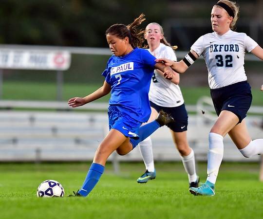 10/10/2018 Mike Orazzi | Staff St. Paul's Zoey Rubins (7) and Oxford's Carley Van Buiten (32) at SPCHS Wednesday night.