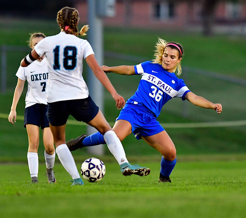 10/10/2018 Mike Orazzi | Staff St. Paul Girls Soccer's Isabella Griffin (36) and Oxford's Jessica Kondic (18) at SPCHS Wednesday night.