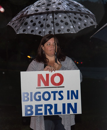 10/11/18 Wesley Bunnell | Staff 17 protestors stood outside of the Berlin Board of Education Department on Thursday evening to protest comments made by Republican candidate for the 30th district Steven Baleshiski. Rachael Rochette holds a No Bigots in Berlin sign.