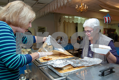 10/12/18  Wesley Bunnell   Staff  Urszula Korycinski, R, looks over the food selections with the help of Gloria Siavrakas at St. George Greek Orthodox Church's fall festival which is being held Friday through Sunday.