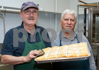 10/12/18  Wesley Bunnell   Staff  Head Chef James Loukas, L, and President Michael T. Michael hold a spinach pie ready to be served at St. George Greek Orthodox Church's fall festival which is being held Friday through Sunday.