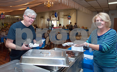 10/12/18  Wesley Bunnell | Staff  Walter Tracy of New Britain is served by Gloria Siavrakas at St. George Greek Orthodox Church's fall festival which is being held Friday through Sunday.