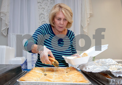 10/12/18  Wesley Bunnell   Staff  Gloria Siavrakas serves a piece of spinach pie at St. George Greek Orthodox Church's fall festival which is being held Friday through Sunday.