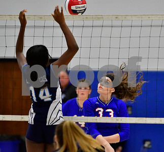 10/11/2018 Mike Orazzi   Staff St. Paul's Kelsi Blatchley (33) and Ansonia's Ruth Sanon (14) Thursday night.