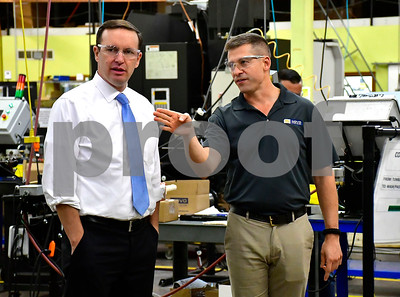 10/12/2018 Mike Orazzi | Staff U.S. Senator Chris Murphy (D-Conn.) talks with Novo Precision President Bill Hazard during a factor tour Friday afternoon.