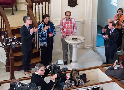 10/16/18  Wesley Bunnell | Staff  Rev. Steve Jungkeit, L stands with Zahida Altaf and Malik Naveed Vin Rehman as the couple show their gratitude to attendees during a press conference at the First Congregational Church of Old Lyme on Tuesday afternoon. The conference was held to announce the couple will return home to New Britain while awaiting their deportation case which is pending before the 2nd Circuit Court of Appeals.  The couple had taken sanctuary at the church in March after being ordered by Customs Enforcement (ICE) to leave the United States by March 19th.