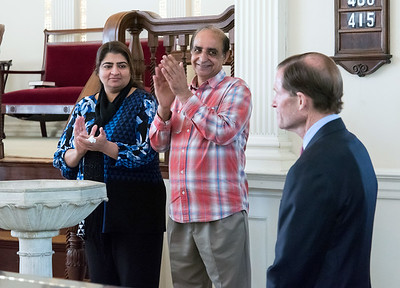10/16/18  Wesley Bunnell | Staff  Zahida Altaf and Malik Naveed Vin Rehman applaud Senator Richard Blumenthal for his work as is introduced during a press conference at the First Congregational Church of Old Lyme on Tuesday afternoon. The conference was held to announce the couple will return home to New Britain while awaiting their deportation case which is pending before the 2nd Circuit Court of Appeals.  The couple had taken sanctuary at the church in March after being ordered by Customs Enforcement (ICE) to leave the United States by March 19th.