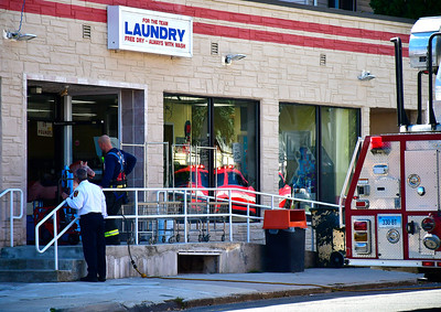 10/17/2018 Mike Orazzi | Staff Bristol firefighters on scene of a dryer fire at For The Team Laundry on West Street after a load of towel were dried too long.