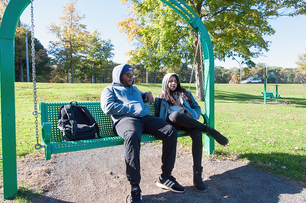 10/18/18 Wesley Bunnell | Staff CCSU students Corey Baptiste, L, and Krystal Rosado enjoy a sunny but chilly fall day on Thursday afternoon at Stanley Quarter Park.