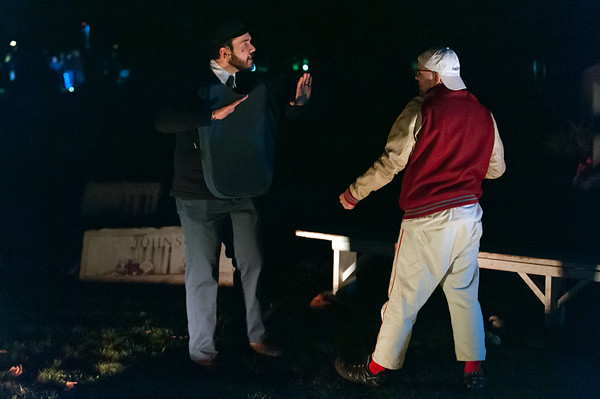 10/18/18 Wesley Bunnell | Staff James Demarco, L, plays New Britain resident and former umpire and National League President Tom Lynch while Duane Black Jr plays nemesis Dirty Jack Doyle on Thursday night at Fairview Cemetery during Timeless Tales 2018. The event which is in its 10th year is run by New Britain Parks & Recreation and Community Services.