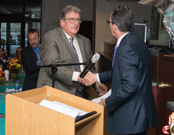 10/18/18 Wesley Bunnell | Staff CMHA held their 2018 Annual Meeting at their new location at on Main St in New Britain on Thursday evening featuring a special award to Governor Dannel Malloy for his help in procuring their new building. President & CEO of CMHA Raymond Gorman shakes hands with Governor Malloy.