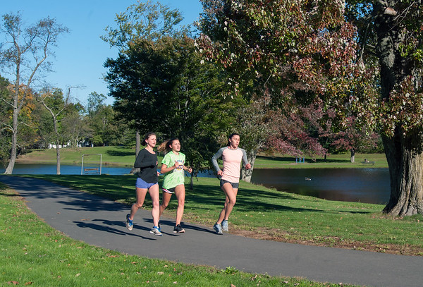 10/18/18 Wesley Bunnell | Staff Members of CCSU's XC team job around the park at Stanley Quarter Park on a chilly but sunny Thursday afternoon.