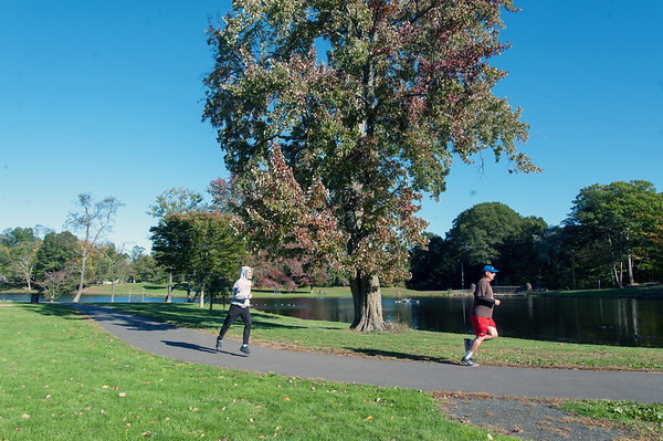 10/18/18 Wesley Bunnell | Staff Joggers pass by the pond area at Stanley Quarter Park on a chilly fall day on Thursday afternoon. Rich Luke , L, decided to jog the park for the first time in 30 years on Thursday since moving away from New Britain.