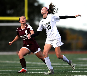 10/19/2018 Mike Orazzi | Staff Bristol Central's Faith Roy (4) and Enfield's  Madison Daly (13) at Central on Friday.
